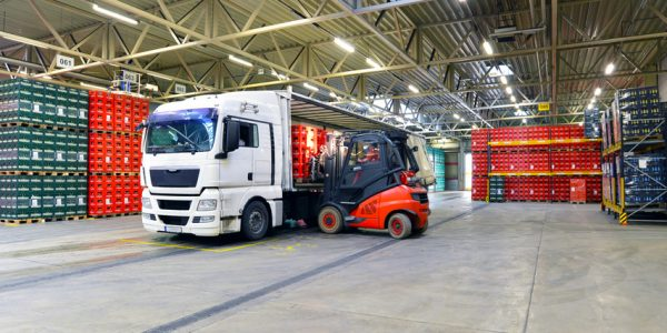 shipping - loading of a truck in a warehouse by forklift
